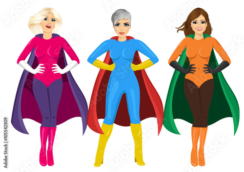 Photo  three beautiful girls in superhero costume standing with hands on hips