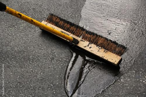 Fotografiet  Sealing a damaged asphalt drive way