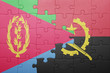 canvas print picture - puzzle with the national flag of angola and eritrea