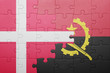 canvas print picture - puzzle with the national flag of angola and denmark