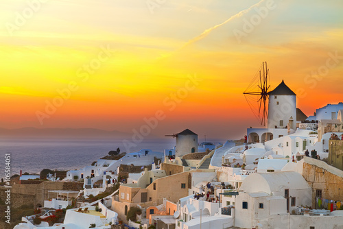 Spoed Foto op Canvas Geel windmill of Oia at sunset, Santorini