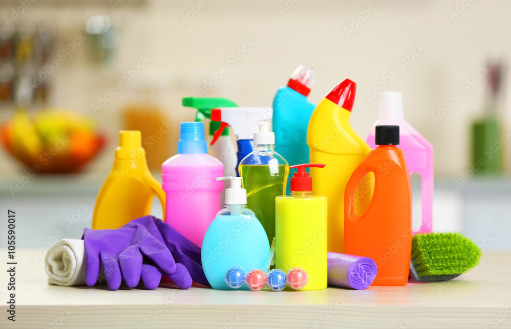 Fototapety, obrazy: Cleaning set with products and tools on kitchen table