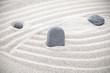 Three stones in sand, zen concept