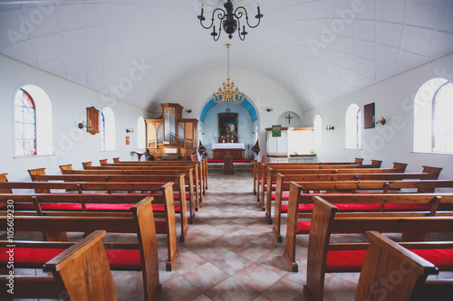 Obraz na plátne A classic catholic lutheran small church interior with no people inside