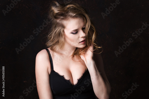 Portrait Of Sexy Woman With Beautiful Breasts In Lingerie On A Dark Background
