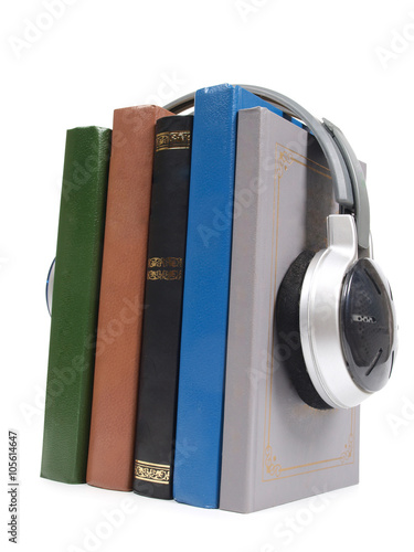 Valokuva  Stack of books and headphones on white background