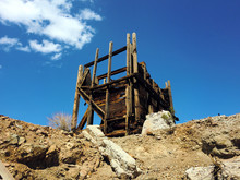 Abandoned Old Silver Mine Wooden Structure In Sun - Landscape Color Photo