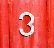 White Number 3 Sign On A Red W...