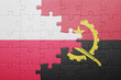 canvas print picture - puzzle with the national flag of angola and portugal