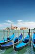 Gondolas parked beside the Riva degli Schiavoni in Venice
