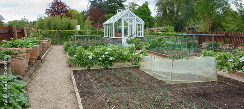 Photo Greenhouse in English country garden
