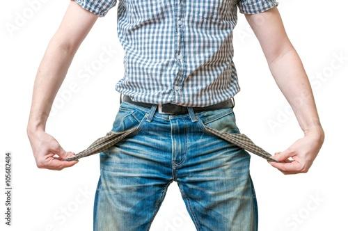 Cuadros en Lienzo Man - debtor is showing empty pockets of his jeans as symbol of no money
