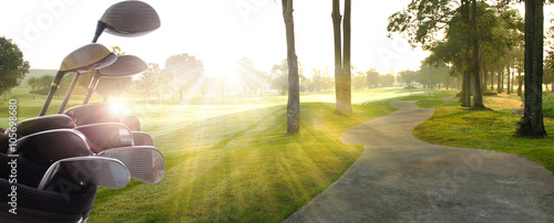 Acrylic Prints Golf Golf clubs drivers over beautiful golf course at the sunset, sunrise time.