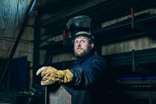 Portrait Of Welder With Beard In Workplace