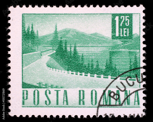 Fotografia  Stamp printed in Romania showing a Lakeside highway, circa 1967.