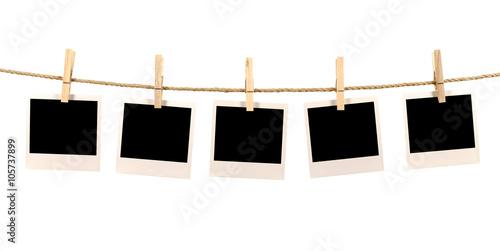 Obraz Several blank polaroid style instant photo print frames hanging - fototapety do salonu