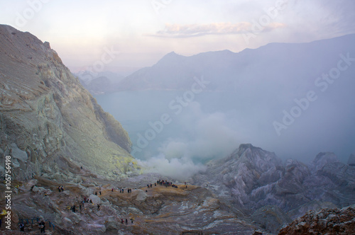 Ijen volcano in East Java contains the world's largest acidic volcanic crater lake, called Kawah Ijen, spewing out sulphur smoke in the morning Wallpaper Mural