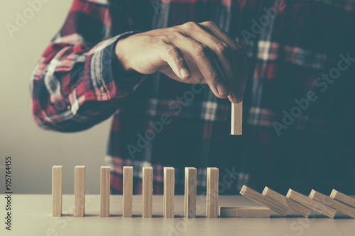 Fotografía  Planning, risk and strategy in business, man pushing wooden block