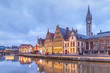 canvas print picture - Picturesque medieval buildings on the quay Graslei and Leie river at Ghent town in the evening, Belgium