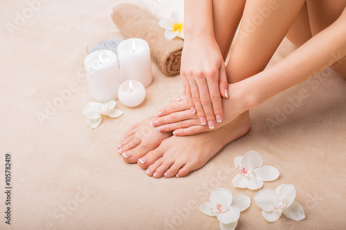 Poster Pedicure Woman at spa with done manicure and pedicure