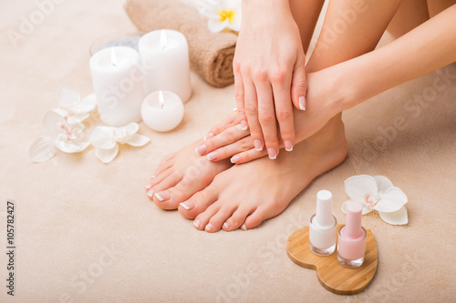 Women at spa salon after manicure and pedicure Poster
