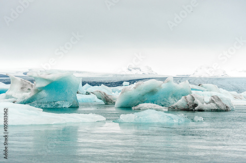 Aluminium Prints Glaciers Jokulsarlon Ice Lagoon in Iceland. Landscape with water and Ice. Mountain in Background