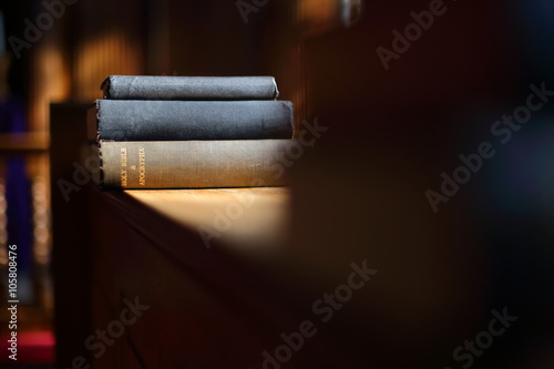 Bible book in the sunny church Canvas Print