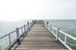 The wooden bridge walkway into the sea.