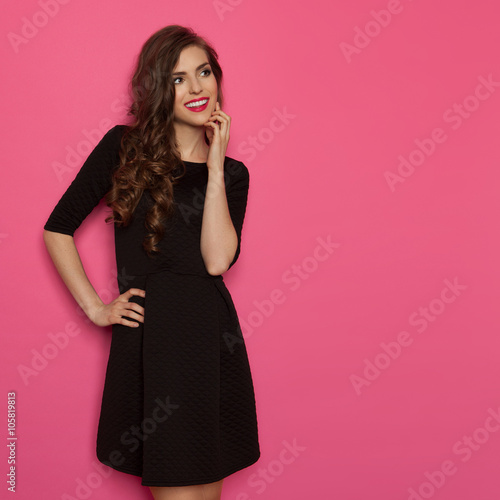 Fotografie, Obraz  Cheerful Girl In Black Mini Dress