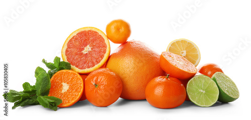 Canvas Prints Fruits A heap of mixed citrus fruit sliced and unpeeled with mint sprigs isolated on a white background, close up
