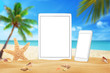 White tablet and smart phone with isolated white screen for mockup. Summer on beach, sea, sand, blue sky, palm, starfish and shells.