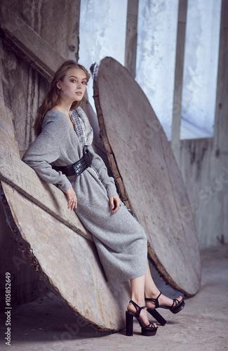 Fotografie, Obraz  A woman in a long grey dress.