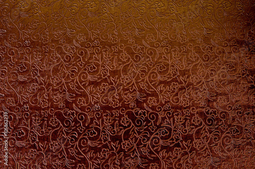 Fotografía  Texture of red satin fabric with floral embossing.