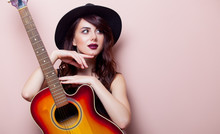 Portrait Of A Young Beautiful Woman With Guitar