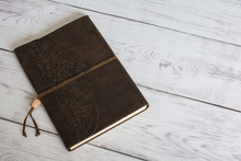 Classic Leather Bound Journal Book On A White Barn Board Floor
