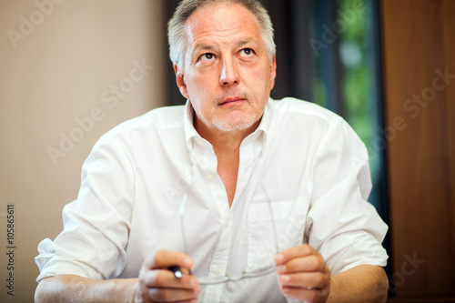 Fotografija  Portrait of a pensive businessman