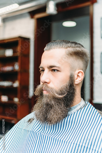 Fototapety, obrazy: Handsome man with a long mustache in barbershop