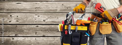 Obraz Builder handyman with construction tools. - fototapety do salonu