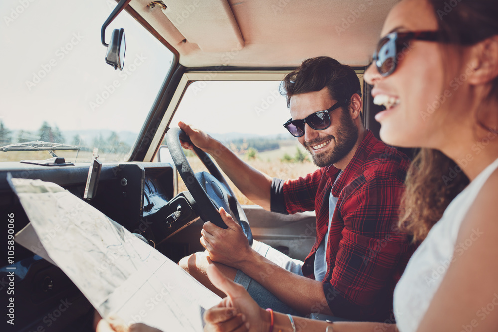 Fototapety, obrazy: Happy young couple with a map in the car
