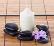 Spa concept: zen stones, candles and flowers
