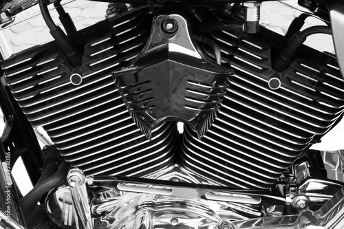 Fényképezés  Motorbike's chromed engine black and white background