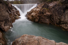 Waterfall In Mountain River