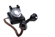 A Black Rotary Phone With The ...