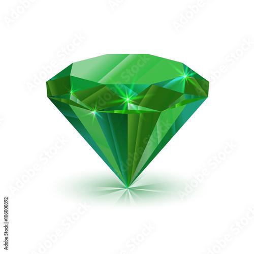 Fotografiet Dazzling shiny green emerald on white