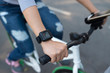 Woman checking her pulse when cycling, selective focus