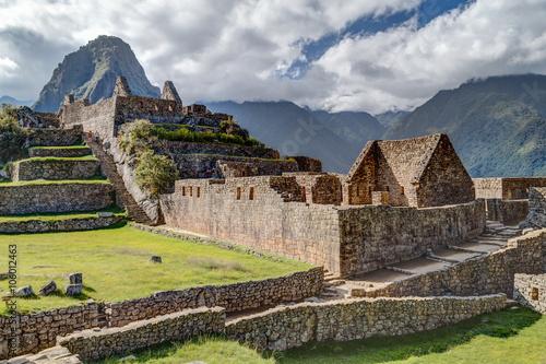 Photo  Ruins of old buildings in Machu Picchu, city of Incas in  Peru