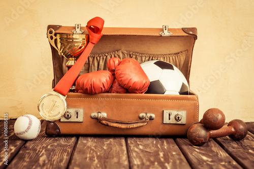 Vintage sport items in suitcase