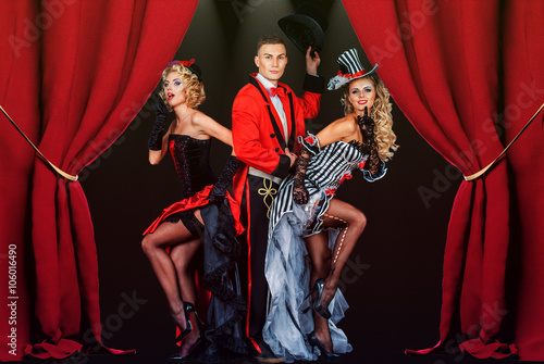 two pretty young blonde girls with men in formal retro clothes dancing Broadway Canvas Print