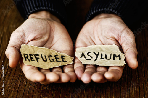 pieces of paper with words refugee and asylum Canvas Print
