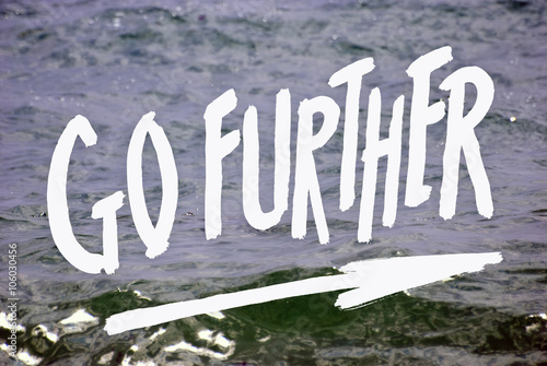 Go further. Hand written white words on the sea background. Canvas Print